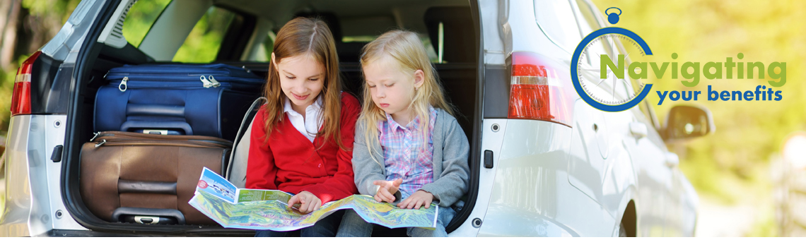 two girls sitting on the back of an SUV looking at a map, with the Navigating Your Benefits logo is in the top, right-hand corner